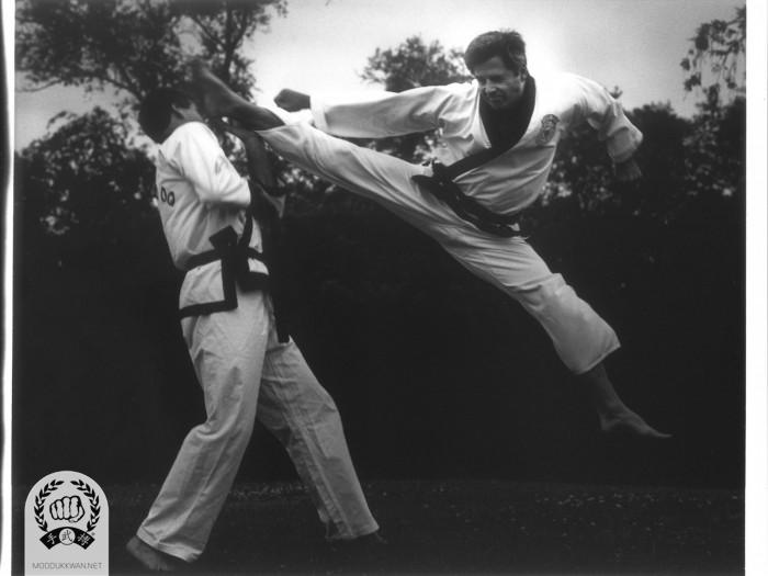 Martinov Sa Bom Nim displaying one of his many signature jump kicks.
